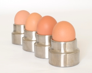 Four eggs in egg cups
